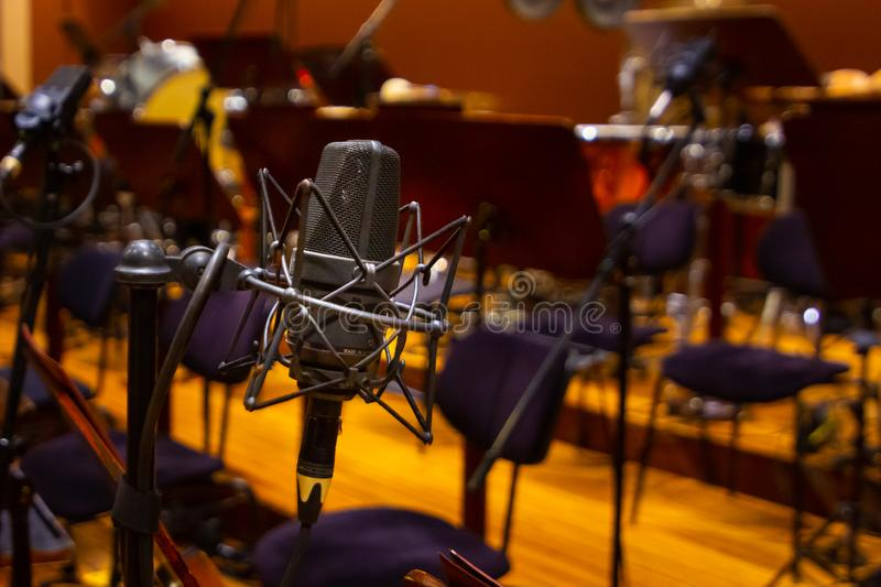 Microphone with a stand close up. Musical instruments of the Orchestra in philharmonia royalty free stock images