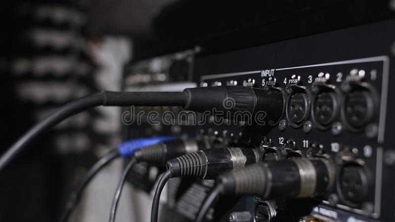 Microphone on a stand located in a music studio recording booth under low key light.  stock photo