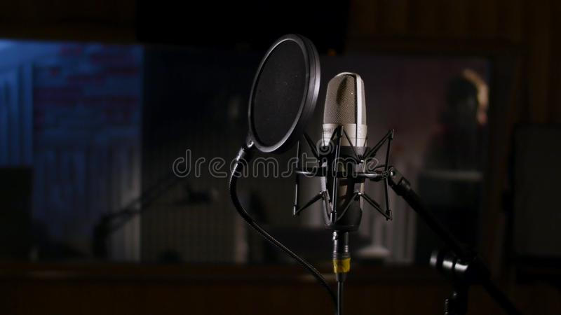 Download Microphone On A Stand Located In Music Studio Recording Booth Under Low Key Light