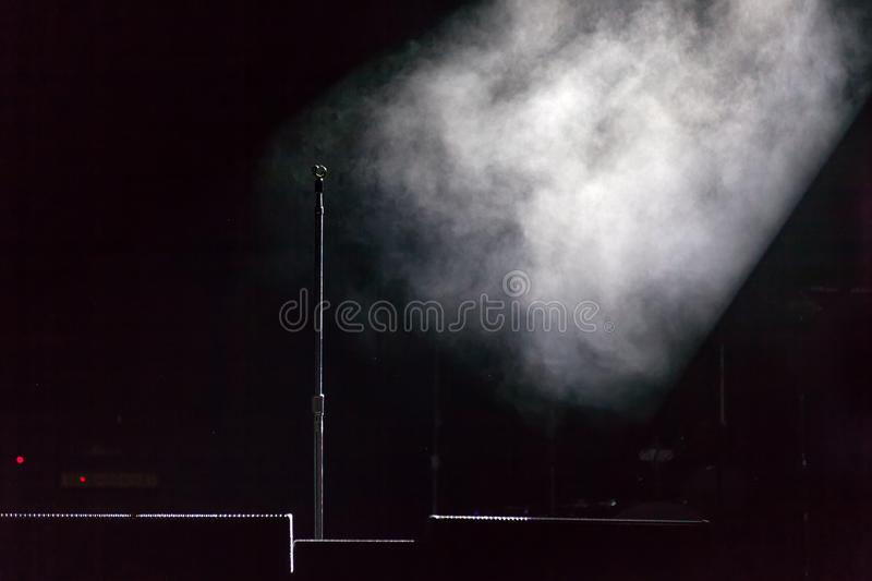 Microphone stand on stage royalty free stock photography