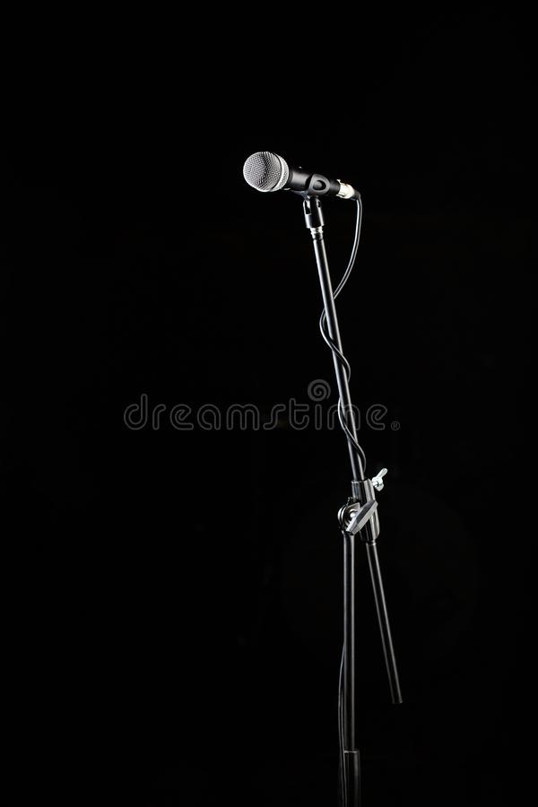 Microphone stand, microphone voice, closeup mic. Karaoke, concert, voice music. Vocal audio mic on a black background stock photography