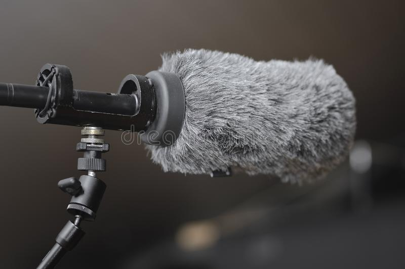 Microphone used in TV and film production. Microphone with windshield used in TV and film production stock images