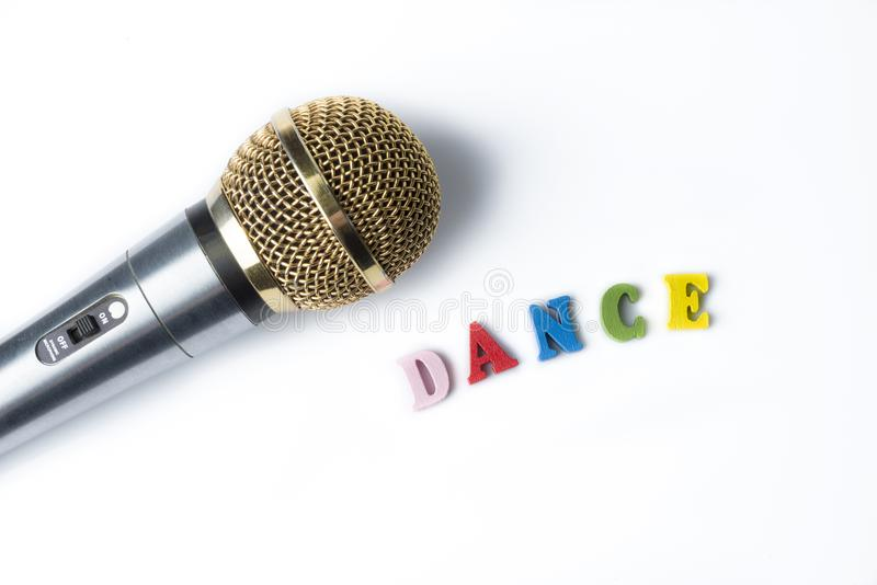 Microphone on a white background with the word dance. royalty free stock photos