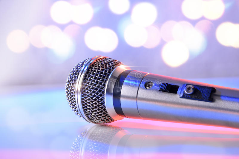Microphone on white crystal table and pastel bokeh background stock photos