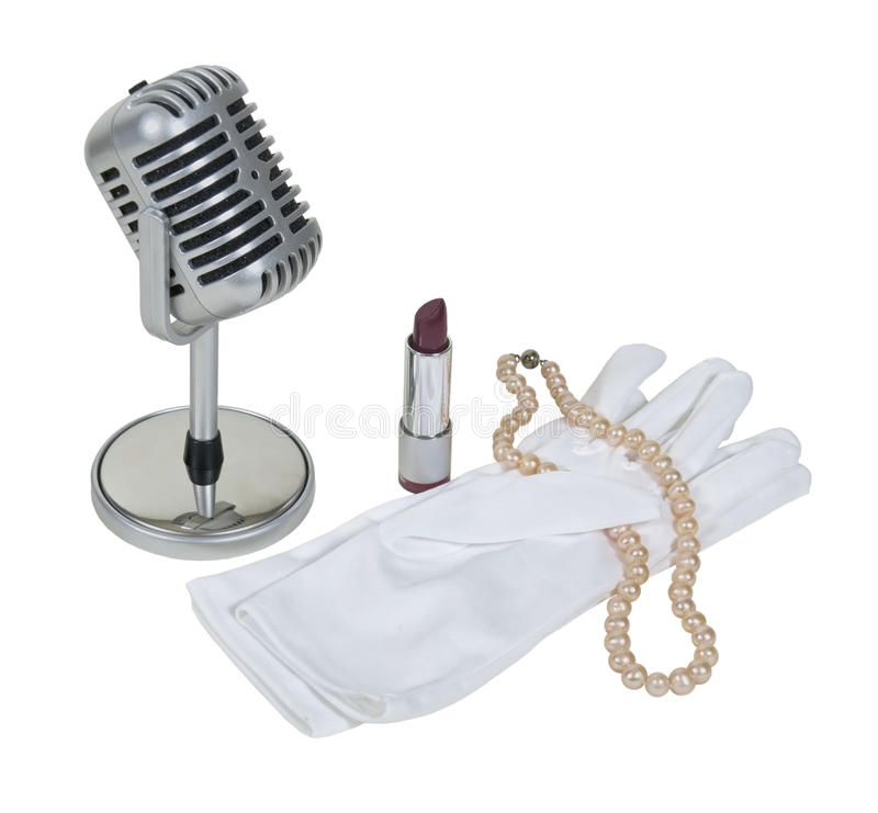 Microphone with White Gloves, Pearls and Lipstick stock photo