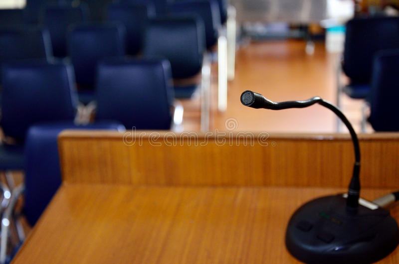 Microphone on wooden podium royalty free stock photography