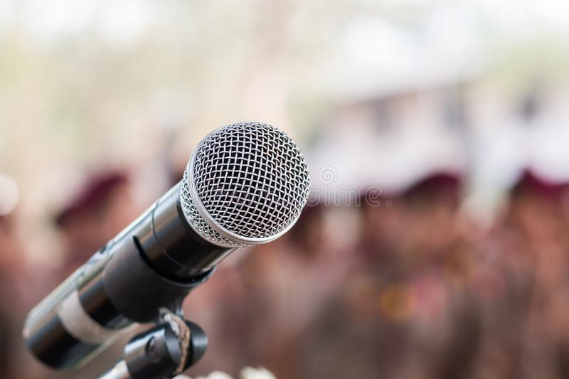 Microphones on abstract blurred of speech in seminar room, speaking conference hall light for presentation in exhibition event royalty free stock photo
