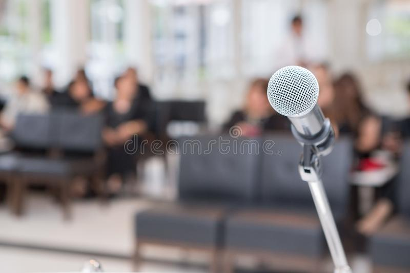 Microphone on the funeral podium and people wearing black in the church. Microphones on the funeral podium and people wearing black in the church royalty free stock photography