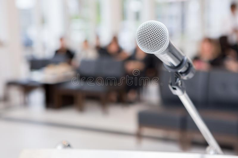 Microphone on the funeral podium and people wearing black in the church. Microphones on the funeral podium and people wearing black in the church stock photo