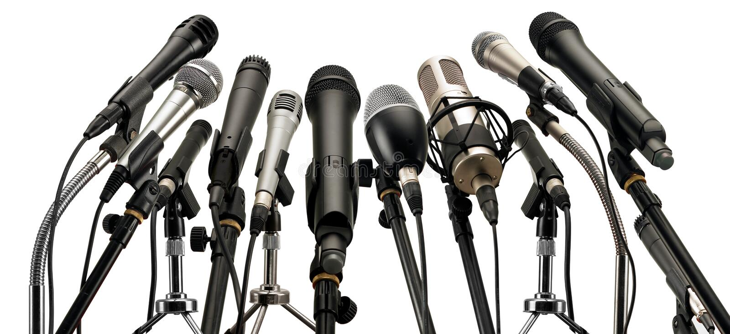 Microphones on podium. Medium group of microphones on podium