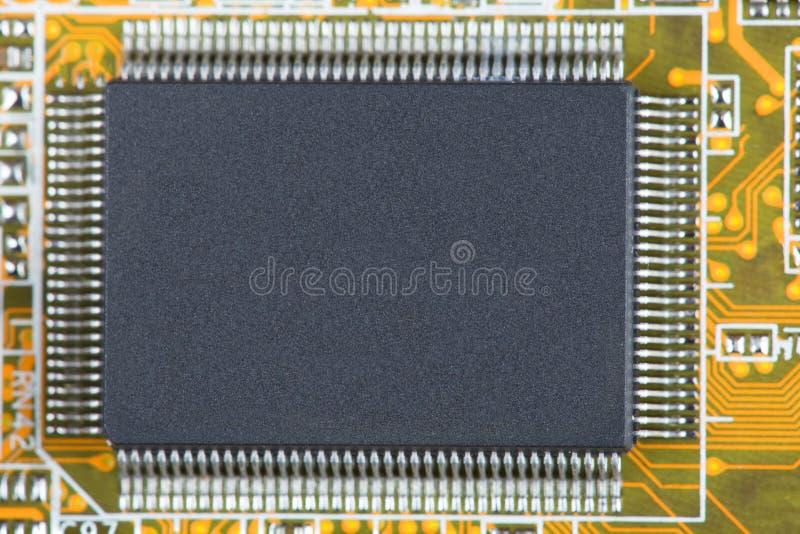 Microplaqueta no fim da placa acima imagem de stock royalty free