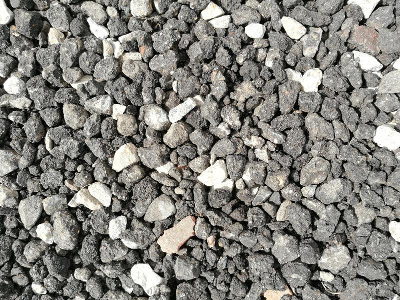 Microplaquetas cinzentas do asfalto como o pavimento imagens de stock