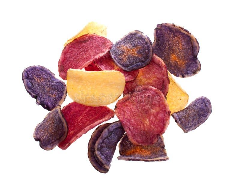Microplaquetas de batata coloridas imagens de stock