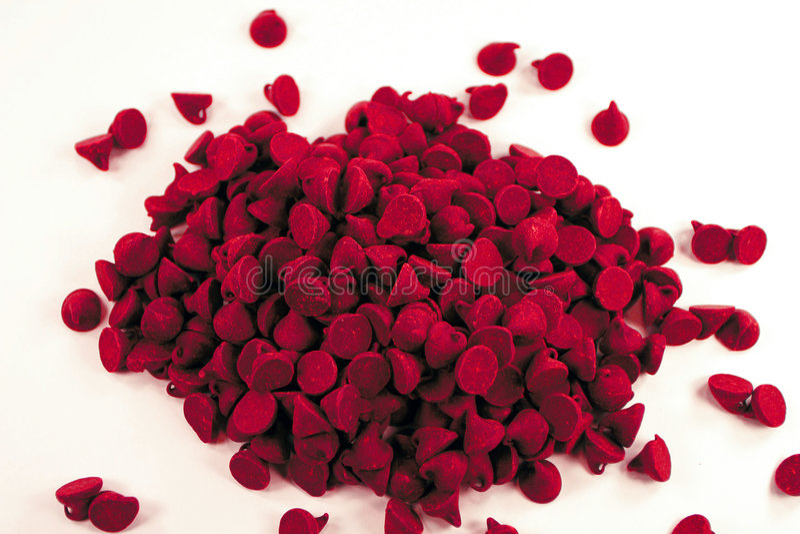 Microplaquetas de chocolate vermelhas foto de stock royalty free