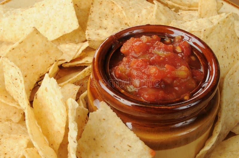 Microplaquetas e close up da salsa foto de stock royalty free