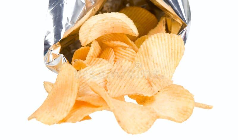 Microplaquetas saborosos das batatas douradas imagens de stock