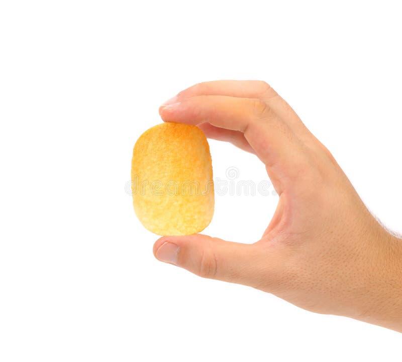 Microprocesador del asimiento de la mano de la patata. imagen de archivo