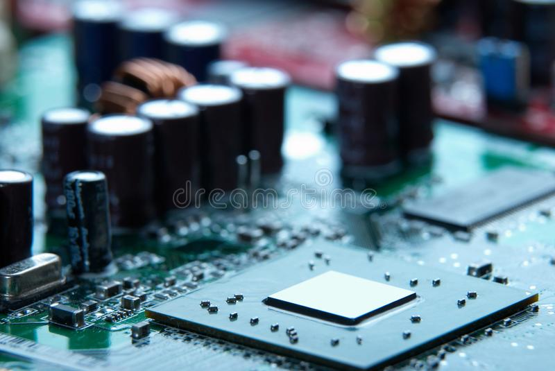 Microprocessor with motherboard background. Computer board chip circuit. Microelectronics hardware concept. stock images