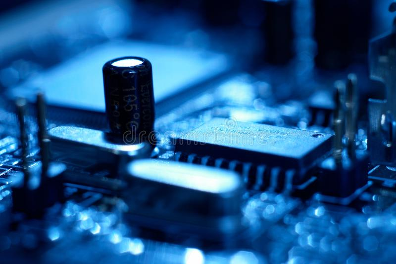 Microprocessor with motherboard background. Computer board chip circuit. Microelectronics hardware concept. royalty free stock photos