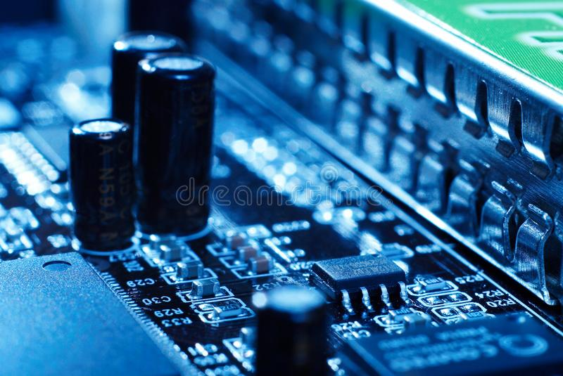 Microprocessor with motherboard background. Computer board chip circuit. Microelectronics hardware concept. royalty free stock images