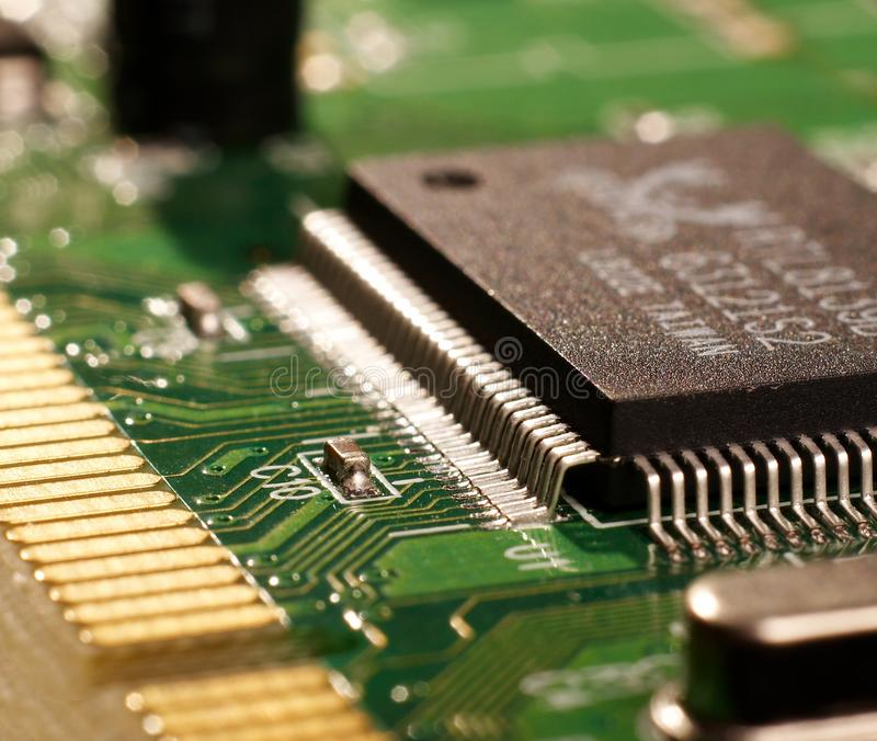 Microprocessor with motherboard background. Computer board chip circuit. Microelectronics hardware concept. royalty free stock photography