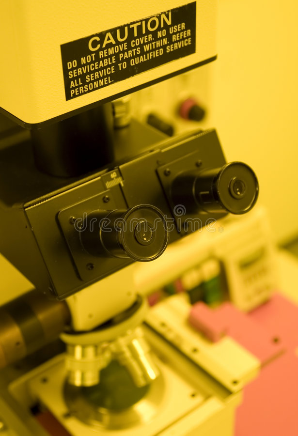 Microscope. UV Mask-aligner in the cleanroom for semiconductor processing (in yellow room royalty free stock photography