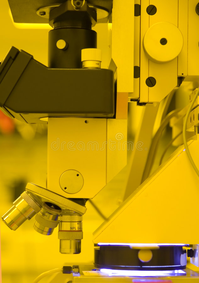 Microscope. UV Mask-aligner in the cleanroom for semiconductor processing (in yellow room stock photography