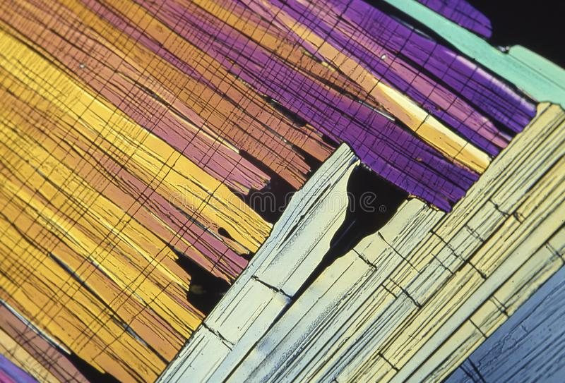 Microscope crystals using dual polarizer. Microscope crystals were taken with a 35mm camera mounted on a low power microscope.  Crystals were dried between two royalty free stock photography