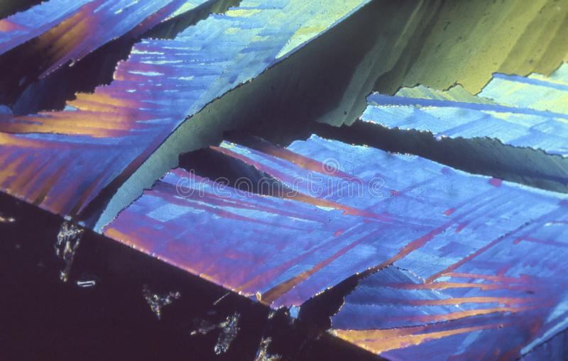 Microscope crystals using dual polarizer. Microscope crystals were taken with a 35mm camera mounted on a low power microscope.  Crystals were dried between two royalty free stock photo