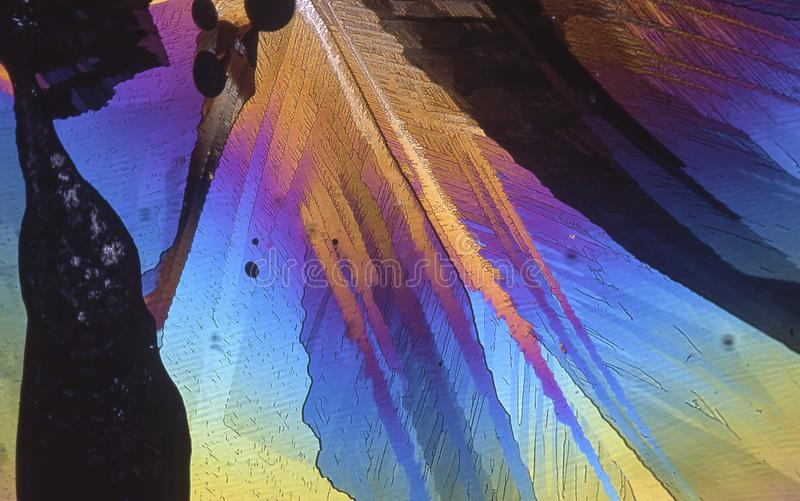 Microscope crystals using dual polarizer. Microscope crystals were taken with a 35mm camera mounted on a low power microscope.  Crystals were dried between two royalty free stock images