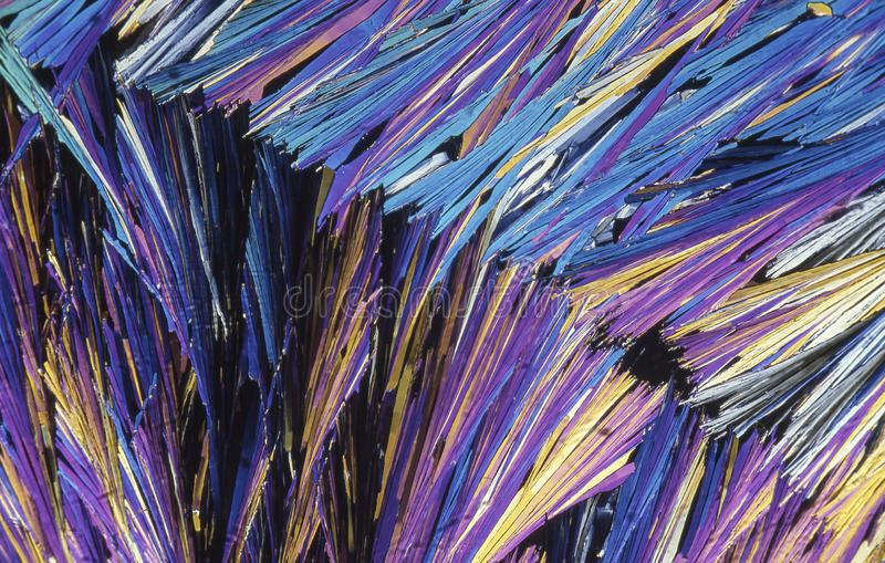 Microscope crystals using dual polarizer. Microscope crystals were taken with a 35mm camera mounted on a low power microscope.  Crystals were dried between two stock photography