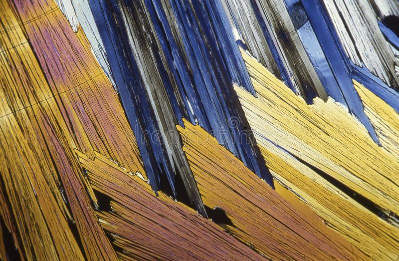 Microscope crystals using dual polarizer. Microscope crystals were taken with a 35mm camera mounted on a low power microscope.  Crystals were dried between two royalty free stock image