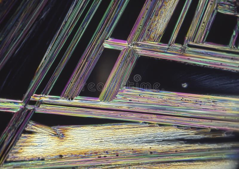 Microscope crystals using dual polarizer. Microscope crystals were taken with a 35mm camera mounted on a low power microscope.  Crystals were dried between two stock photo