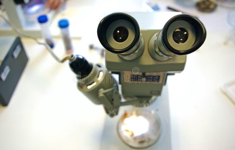 Microscope on desk stock image