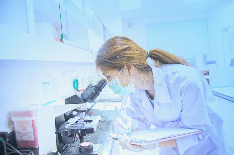 Microscope, examining samples and liquid. Medical research stock images