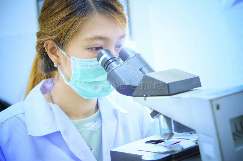 Microscope, examining samples and liquid. Medical research. In hospital stock images
