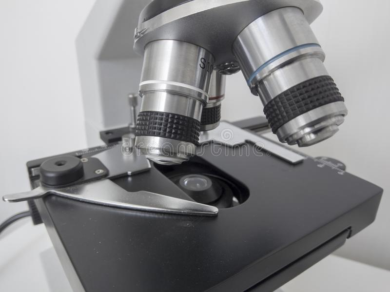 Microscope, examining samples and liquid. technical equipment royalty free stock images