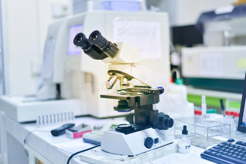 Microscope laboratory equipment medical science background. royalty free stock image