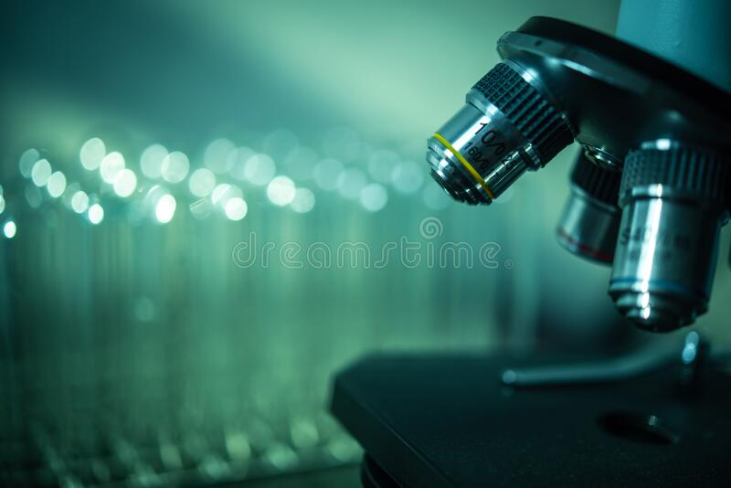 Microscope and laboratory test tube , science research concept.  stock image