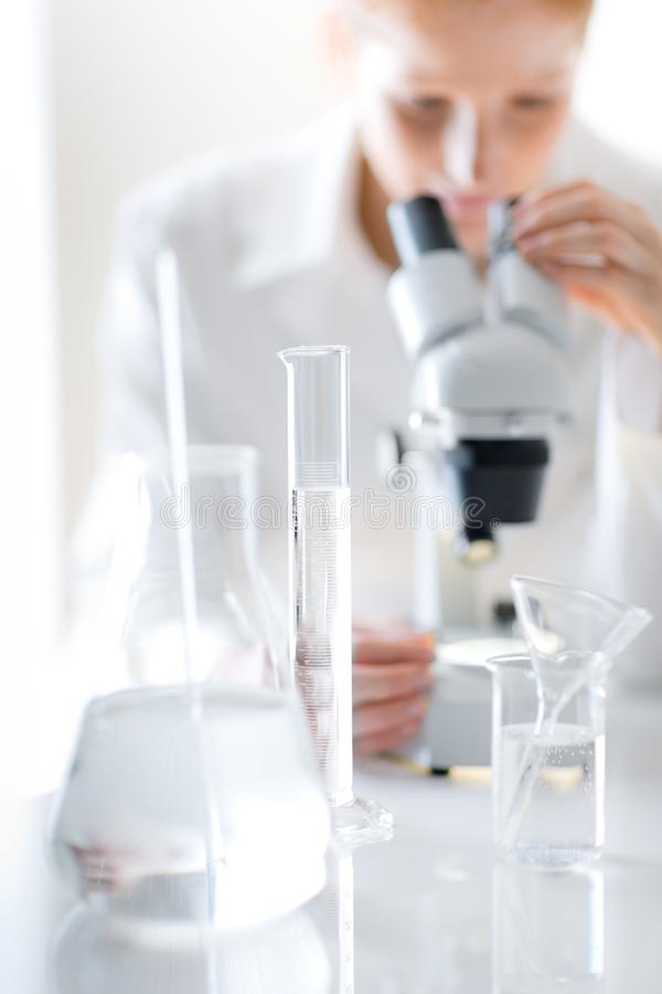 Microscope laboratory - woman medical research. Chemist experiment, shallow depth-of-field royalty free stock photos