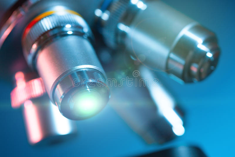 Microscope lens with stock photo