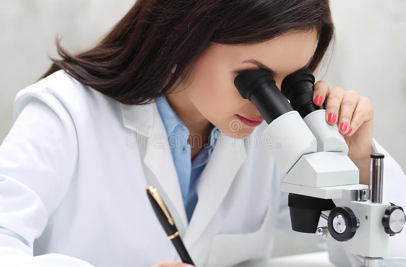 Microscope. Professional. Scientist with microscope at work stock image