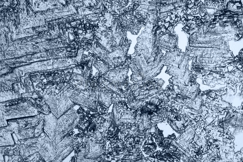 Microscopic microcrystal background. Cool toned microscopic shot showing some microcrystals stock photos