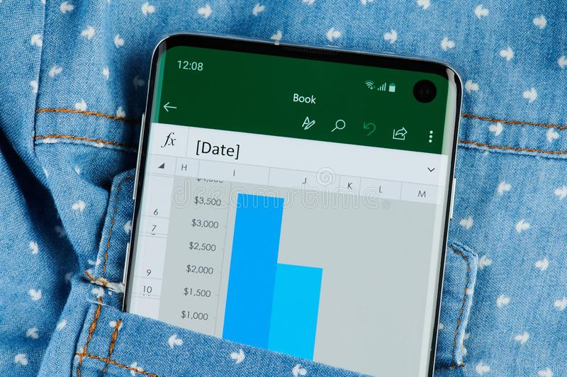 Microsoft excel application on smartphone. New york, USA - June 28, 2019: Microsoft excel application on smartphone screen close up view in shirt pocket royalty free stock photography
