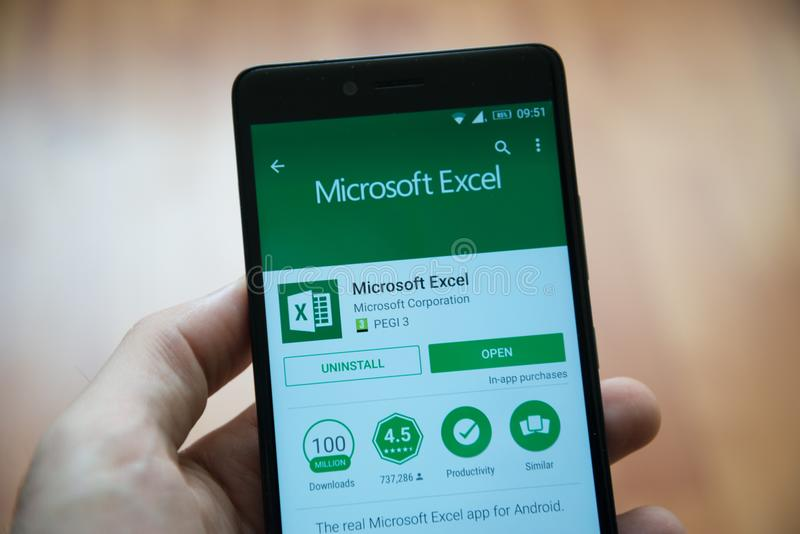 Microsoft office excel application in google play store. Los Angeles, november 2, 2017: Man hand holding smartphone with Microsoft office excel application in royalty free stock photography
