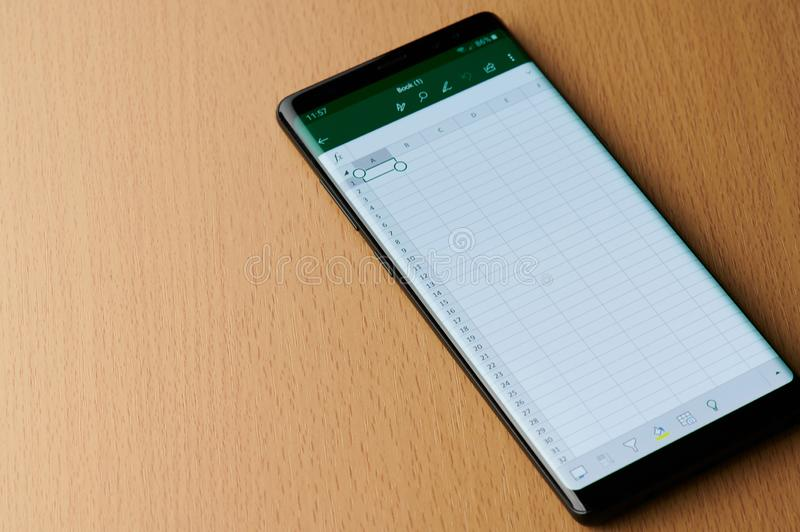 Microsoft office excel menu. New york, USA - march 6, 2019: Microsoft office excel menu on smartphone screen laying on wooden desk royalty free stock images