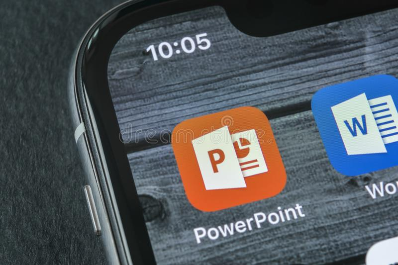 Microsoft office Powerpoint application icon on Apple iPhone X screen close-up. PowerPoint app icon. Microsoft Power Point. Sankt-Petersburg, Russia, April 11 royalty free stock photos