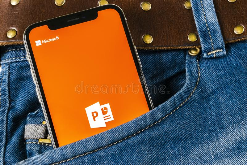 Microsoft office Powerpoint application icon on Apple iPhone X screen close-up in jeans pocket. PowerPoint app icon. Microsoft Pow. Sankt-Petersburg, Russia stock photo