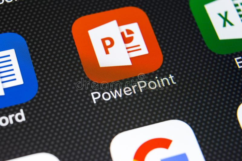 Microsoft Powerpoint application icon on Apple iPhone X screen close-up. PowerPoint app icon. Microsoft Power Point application. Sankt-Petersburg, Russia stock photography