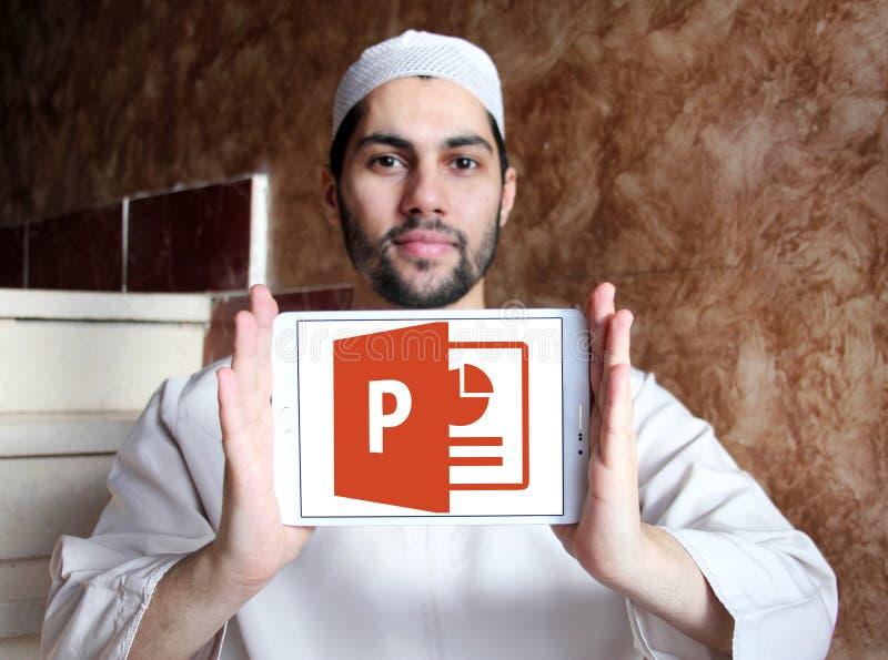 Microsoft powerpoint logo. Logo of microsoft office powerpoint program on samsung tablet holded by arab muslim man stock photos